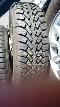 FULL SET 3 MONTHS USE GOODYEAR NORDIC 215-70-15 Tires on Ford Alloy Rims Angus