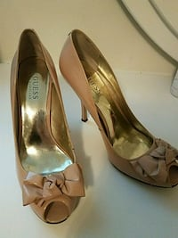 pair of brown Guess leather peep-toe pumps with bow accents