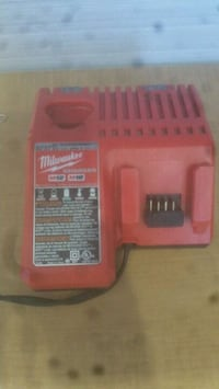 red and black Milwaukee power tool battery