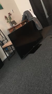 black flat screen TV with remote Enfield, 03748