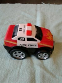 toddler's red and white Fire chief plastic toy car Nanaimo, V9R 2T2