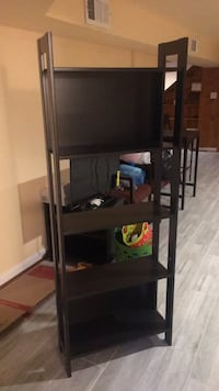 black flat screen TV with brown wooden TV hutch Alexandria, 22303