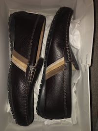 Pair of brown leather loafers 544 km