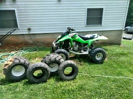 green and black ATV quad bike