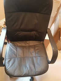 black leather padded rolling armchair Calgary, T3J 1Z7
