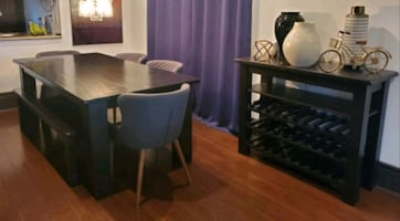 Dinning table and wine hutch cabinet.