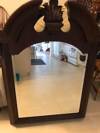 rectangular mirror with brown wooden frame North Palm Beach, 33408