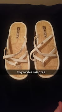 Pair of brown-and-white Roxy sandals