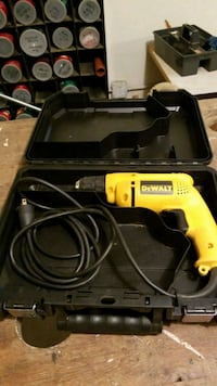 Yellow and black dewalt corded power drill Winchester, 01890