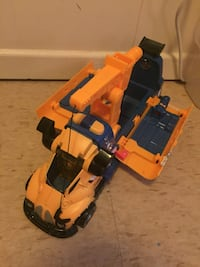 yellow and blue toy crane truck