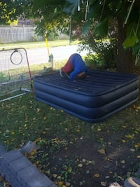 blue and black inflatable bed 665 km