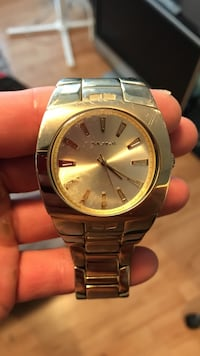 Round gold analog watch with gold link bracelet Port Moody, V3H 2C6