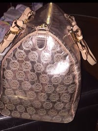 Like new barely ever used large metallic gold Michael Kors tote.  12.5L x 10H x 5.5W Jupiter, 33478