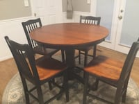 round brown wooden table with four chairs dining set GERMANTOWN