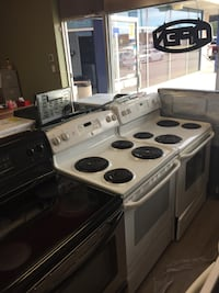 white and black electric coil range oven null