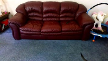 Burgundy couch and loveseat