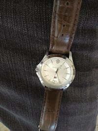 round silver analog watch with brown leather strap Los Angeles, 90003