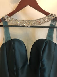 Emerald green formal gown. Perfect combination of jewels and pearls to add a touch of glam! McAllen, 78504