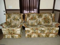 two white-and-green floral sofa chairs 207 mi
