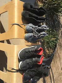 four pair of assorted-color basketball shoes