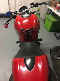 Red Ducati sports bike Saint Cloud, 34772