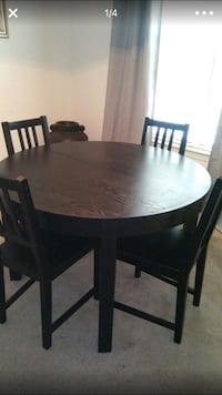 Round brown wooden table with 4 chairs set screenshot