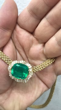 Yellow gold diamond and emerald neacklace New York, 10036
