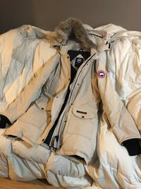 two white and brown zip-up jackets 702 km