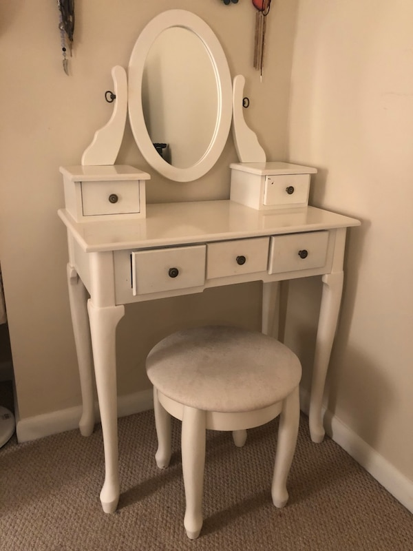 White wooden vanity table with mirror