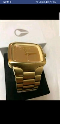 square gold-colored analog watch with link bracelet 3154 km