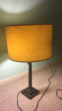 black metal-based table lamp with round brown lampshade Gainesville, 20155