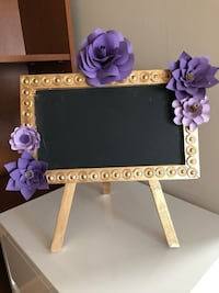 Chalkboard sign, with paper flowers. Vancouver, V6B