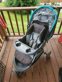 baby's gray and blue jogging stroller