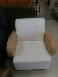 White leather padded sofa chair