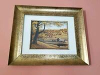 brown wooden framed painting of house 40 km