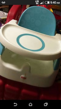 baby's white and blue fisher price plastic highchair