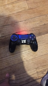 black and blue Sony PS4 controller