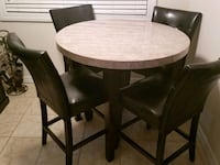 round brown wooden table with four chairs dining s Patchogue, 11772