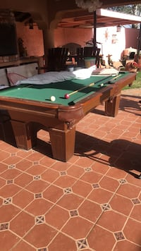 brown and green pool table Lubbock, 79404