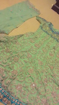glittered green and gold floral traditional dress