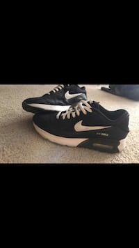 pair of black-and-white Nike running shoes North Las Vegas, 89032
