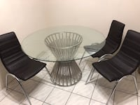 Round black wooden table with four chairs Richmond, V6Y 1N4
