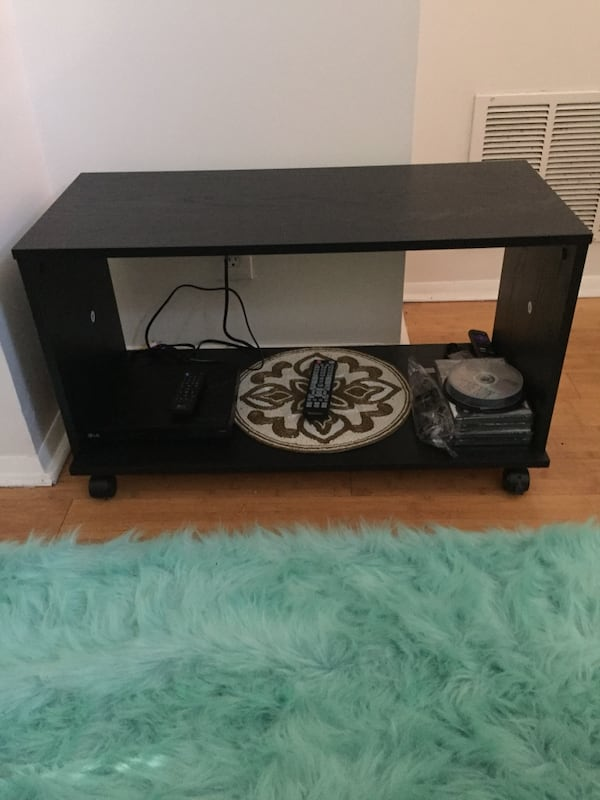 TV stand- price negotiable e07bcbeb-4600-435a-a68b-d34b82e9ddc4