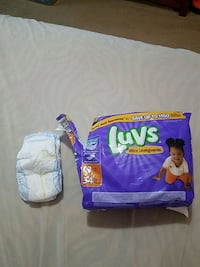 Opened - size 3 diapers Baxter, 50028