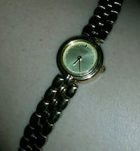 round silver analog watch with link bracelet Seattle, 98104