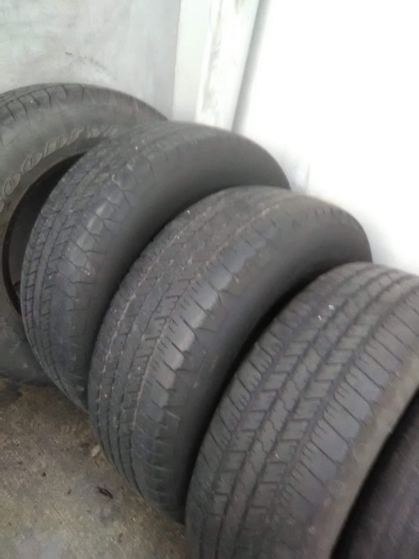 Two black car wheels with tires