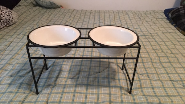 Two round black metal base white wooden top tables