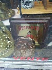 Beefeater mirror with brown wooden frame