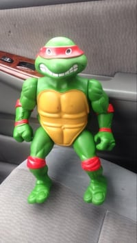 green and red plastic toy