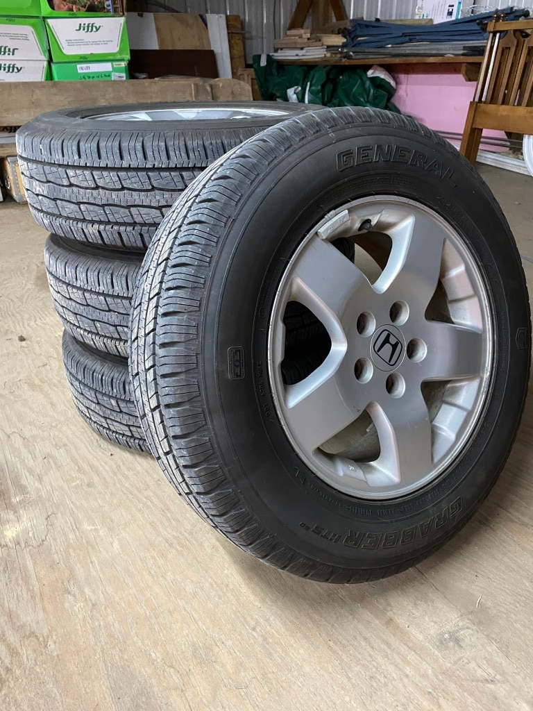 Photo 215/70 r16 general grabbers with honda alloy rims